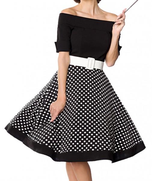 Schwarzes kurzes Swing Kleid im High Waist Schnitt mit Gürtel und Tellerrock weiß gepunktet und schu